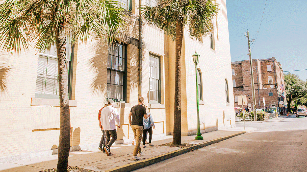 Photo of Focus Lab team members walking on a sidewalk in Savannah, GA.