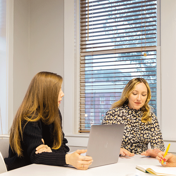 Photo of Focus Lab team members, Haley and Amy, meeting in a conference room.